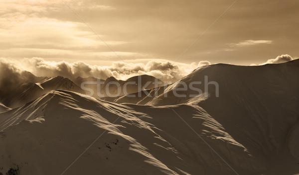 Sepia mountains in mist at sun evening Stock photo © BSANI