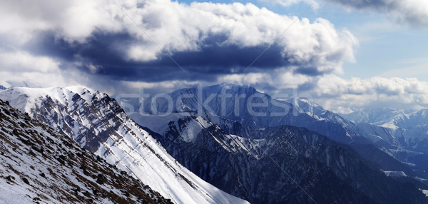 Stock photo: Panoramic view on winter mountains in evening and cloudy sky