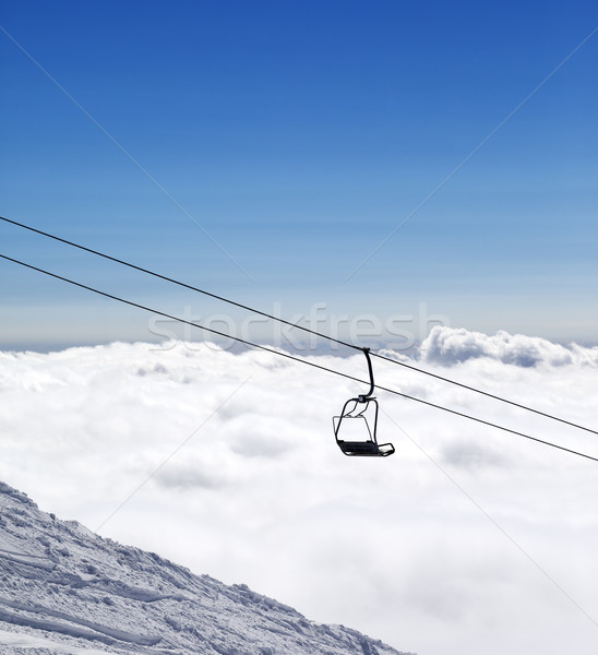 Ski slope, chair-lift and mountains under clouds Stock photo © BSANI