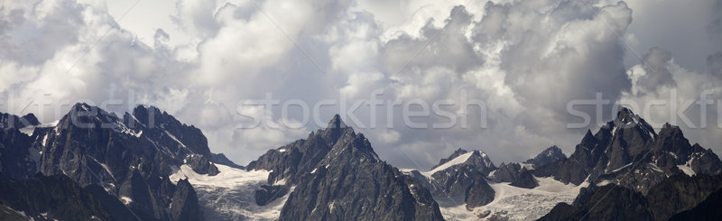 Panorama Caucasus Mountains in clouds Stock photo © BSANI