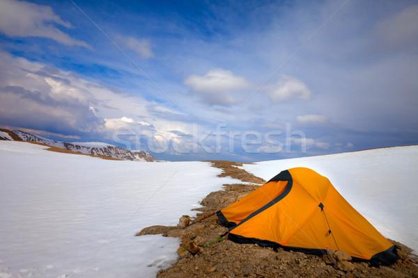 Orange tent in snow mountains Stock photo © BSANI