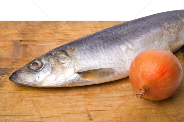 Herring with onion on old wooden cutting board Stock photo © BSANI