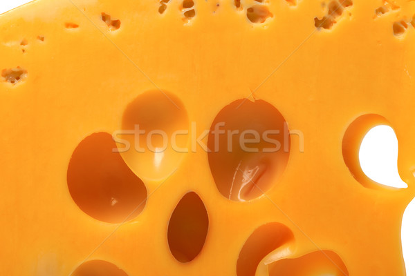 Slice of cheese with hole Stock photo © BSANI