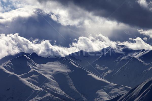 Este hegyek felhők kilátás sí üdülőhely Stock fotó © BSANI