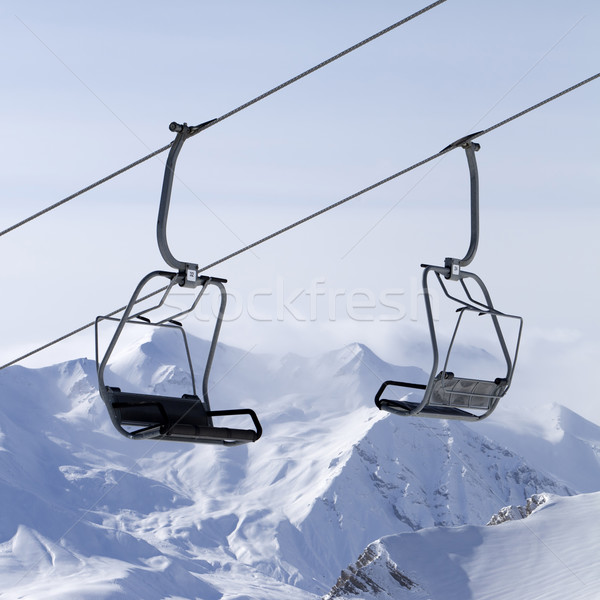 Ropeway at ski resort and mountains in fog Stock photo © BSANI