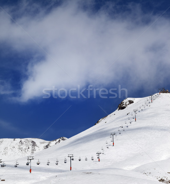 Chair-lift and ski slope in sun day Stock photo © BSANI