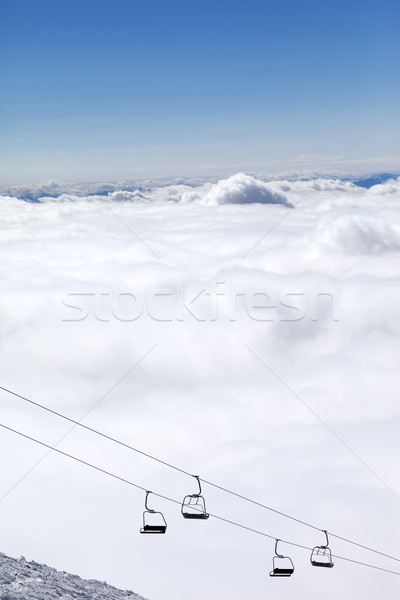 Stock photo: Mountains under clouds and chair-lift