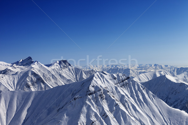 Snowy rocks in nice sun day, view from ski slope Stock photo © BSANI