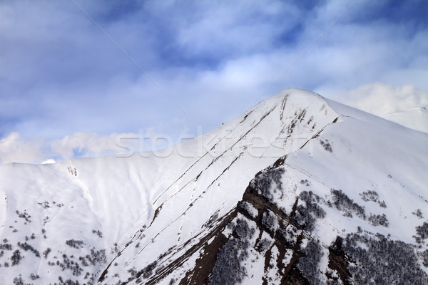 Off-piste slope in morning and sky with clouds Stock photo © BSANI