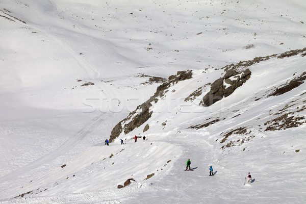 Snowboarders and skiers on ski slope at sun day Stock photo © BSANI