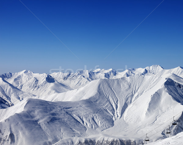 Winter mountains and chair-lift at nice day Stock photo © BSANI