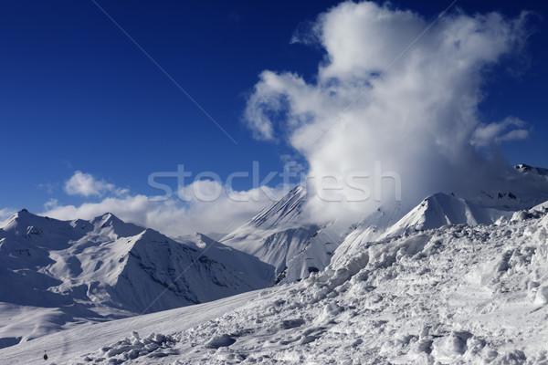 Snowdrift, ski slope and beautiful snowy mountains Stock photo © BSANI