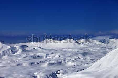 Snowy plateau and off-piste slope at sun day Stock photo © BSANI