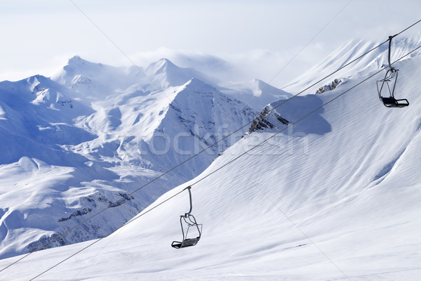 Chair lifts and off-piste slope in haze Stock photo © BSANI