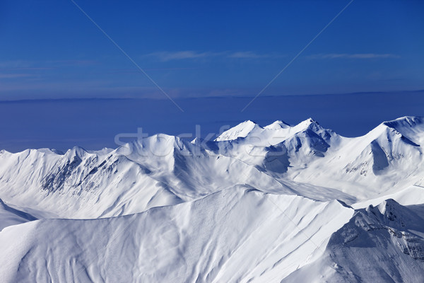 Off-piste snowy slope at sunny day and multicolor blue sky Stock photo © BSANI