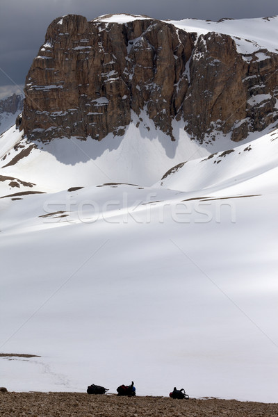 Snowy plateau and three backpack Stock photo © BSANI