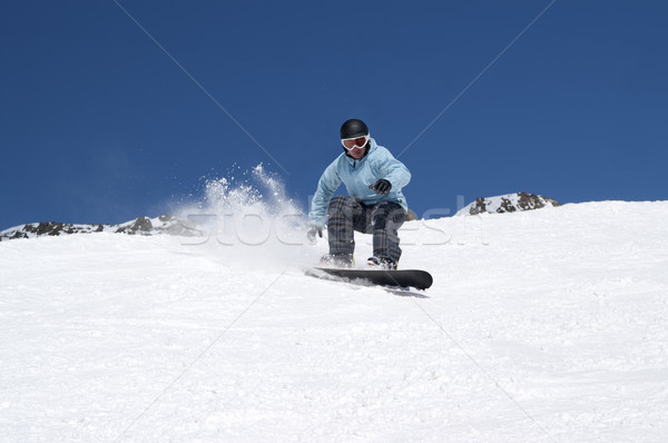 Snowboarding in snowy mountains Stock photo © BSANI