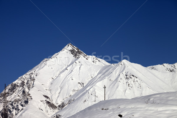 Snowy mountains and blue clear sky in nice day Stock photo © BSANI