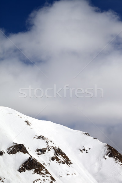 Winter mountains and sky with clouds at sun day Stock photo © BSANI