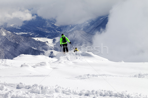 Freeriders on off-piste slope and mountains in mist Stock photo © BSANI