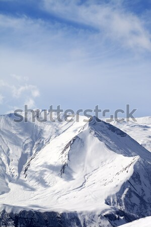 Snowy mountains at sunny day Stock photo © BSANI