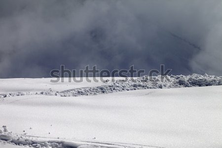 Sunlight off-piste slope and mountains in mist Stock photo © BSANI