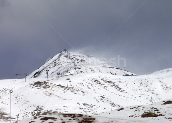 Ski slopes in little snow year at bad weather day Stock photo © BSANI