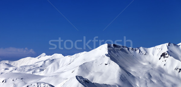 Panoramic view on off-piste snowy slope at sunny day Stock photo © BSANI