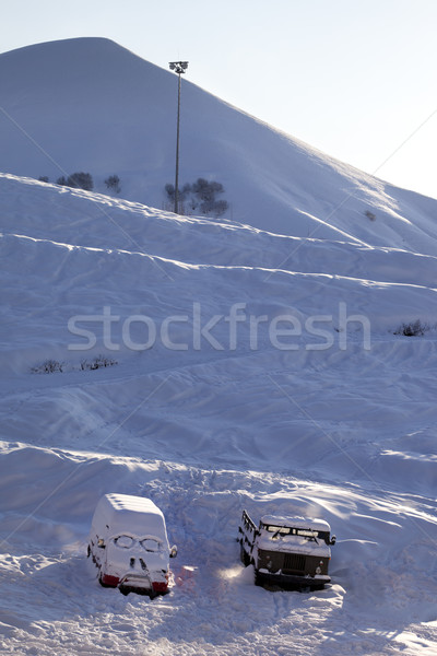 Snow-covered cars with smiley in windshield Stock photo © BSANI