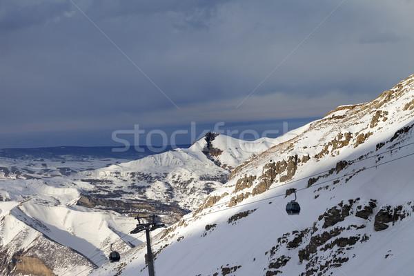 Gondola lift on ski resort at sun evening Stock photo © BSANI