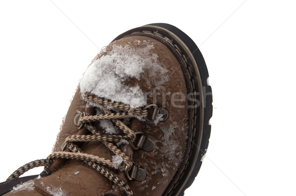 Stock photo: Snow-covered hiking boot
