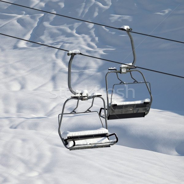 Two chair-lift with snowdrift in sun morning. Close-up view. Stock photo © BSANI