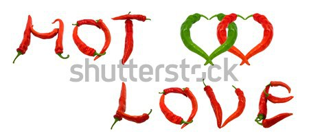 Red and green chili peppers in love. Hearts composed of peppers. Stock photo © BSANI
