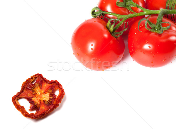 Bunch of raw tomatoes with water drops and dried slice Stock photo © BSANI
