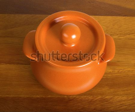 Clay pot on the wooden board Stock photo © BSANI