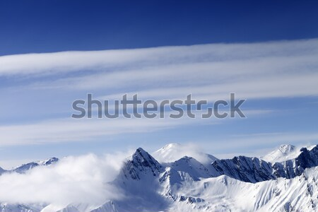 High mountains in haze and blue sky with clouds Stock photo © BSANI