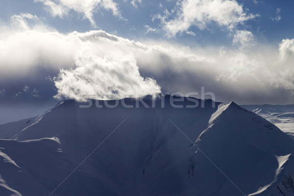 Mountains in evening and sunlight clouds Stock photo © BSANI
