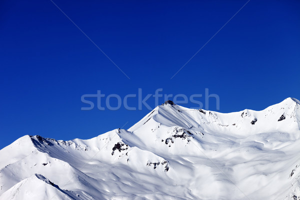 Off-piste slope and blue clear sky in nice winter day Stock photo © BSANI