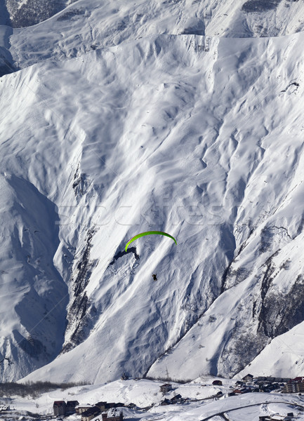 Speed flying in snow mountains in sun nice day Stock photo © BSANI