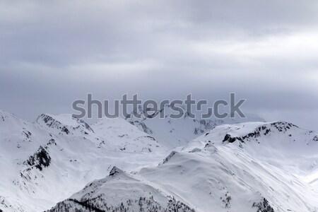 Alto montanhas cinza céu nevasca cáucaso Foto stock © BSANI