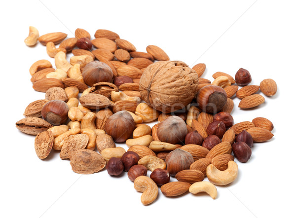 Assortment of raw and roasted nuts Stock photo © BSANI