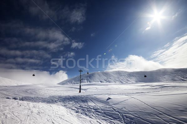 Ski slope, gondola lift and blue sky with sun Stock photo © BSANI