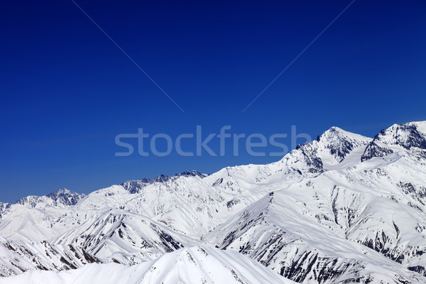 Winter snowy mountains and blue sky Stock photo © BSANI