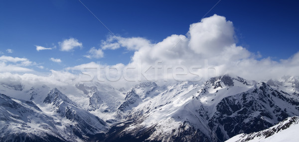 Panorama of Caucasus Mountains in sunny clouds Stock photo © BSANI