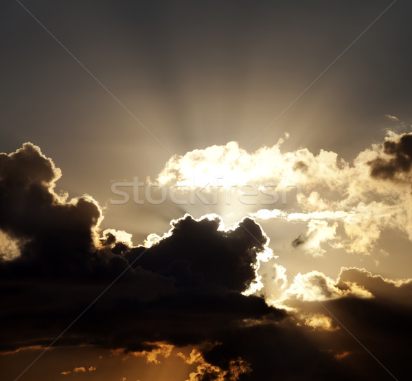 Sunset sky with dark clouds and sun rays Stock photo © BSANI