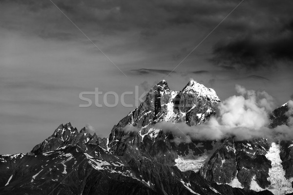 Black and white mountains in clouds Stock photo © BSANI