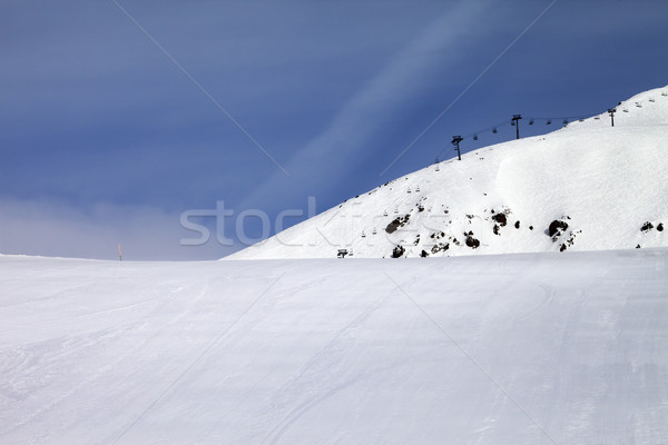 Ski slope and chair-lift against blue sky Stock photo © BSANI