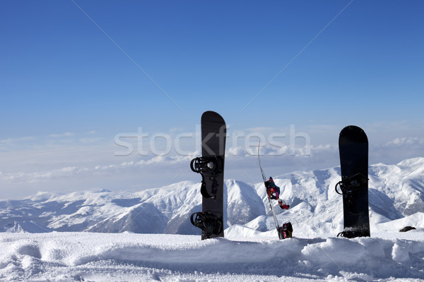 Three snowboards in snow near off-piste slope in sun day Stock photo © BSANI