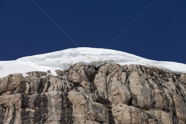 Snow cornice and blue sky Stock photo © BSANI
