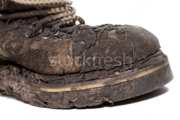 Old dirty hiking boot isolated on white background Stock photo © BSANI